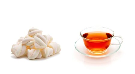 Cup of tea with marshmallows on a white background.