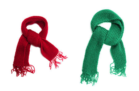 Green and red knitted scarf on a white background. Zdjęcie Seryjne