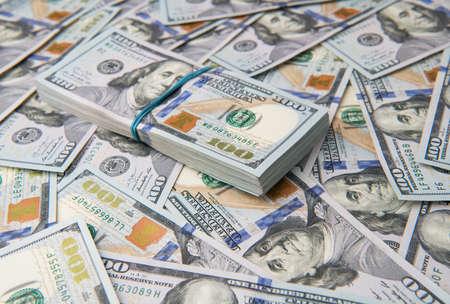 Stack of one hundred dollar bills close-up. Imagens