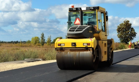 Road works  roller compacted asphalt  Stock Photo