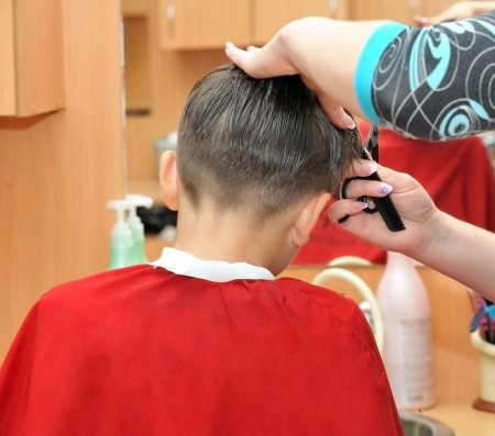 Hands barber cut  hair boy  Stock Photo