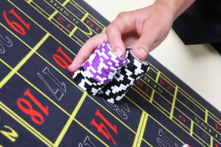 Dealers hand on the chips Stock Photo