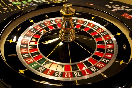 Spinning roulette in casino.