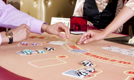 Hand dealer and  player on  table in casino while playing. Stock Photo