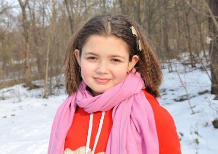 Portrait of girl  on winter background.