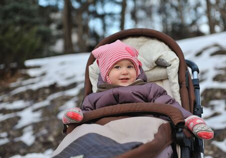 Сute little girl smiling in  park close-up winter day. Stock Photo