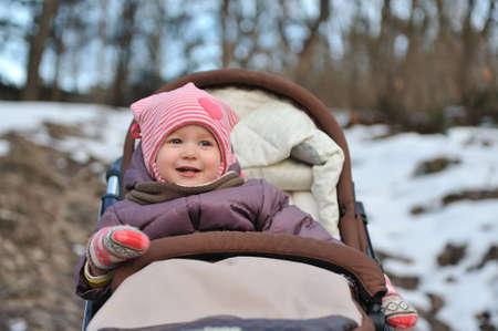 Ð¡ute little girl smiling in  park close-up.