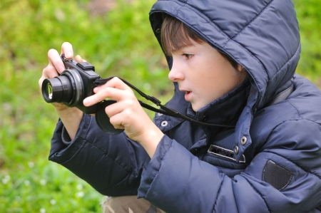 Boy enthusiastically photographed in nature. Stock Photo