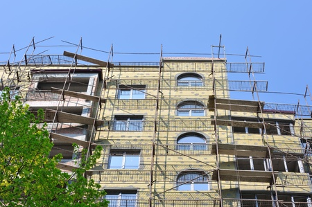 Building under construction against blue sky in spring