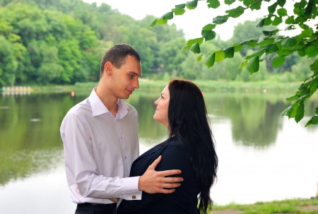 Couple - the guy with the girl looking at each other against the background of the park and nature  Stock Photo - 20436213