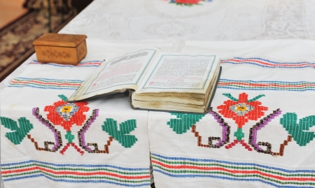 disclosed: Very old book of prayers on the table disclosed in the church
