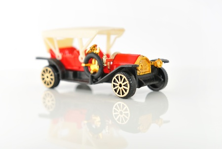 Plastic model of retro cars on white background with reflection  photo