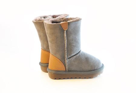 Kids warm winter boots in gray fur.