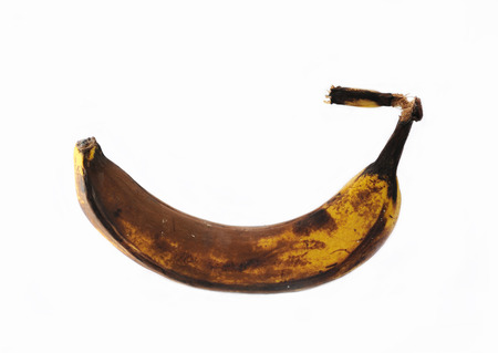 Rotten banana isolated. photo