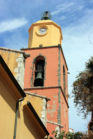 saint tropez: Saint Tropez clock on a colorful tower with a bell.
