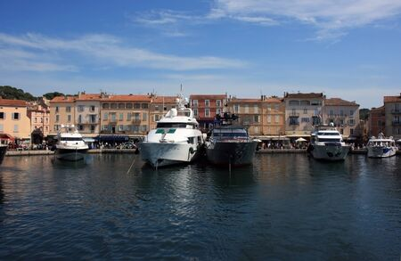saint tropez: Marine view of Saint Tropez quay with luxury yachts and colorful houses