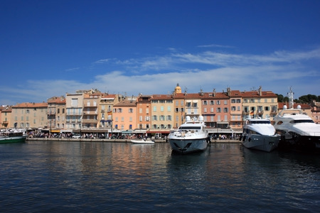 the quay: Marine view of Saint Tropez quay with luxury yachts and colorful ancient houses  Stock Photo