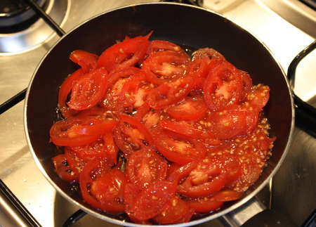 sause: Cooking traditional italian tomato sauce for pasta in pan