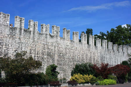 encircling: Fragment of medieval defence wall that was encircling Trento in XIV-XVI centuries Stock Photo