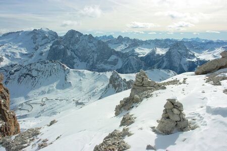 Touristic stone pyramids against Dolomites range photo