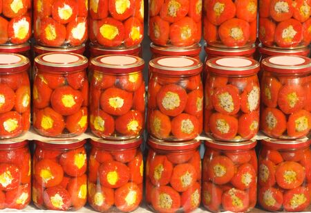 Set of glass jars with canned pepper in vinegar Stock Photo - 2770286