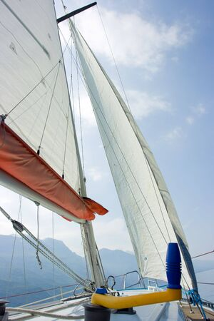 ander: Being exactly ander mast, sail and ropes Stock Photo