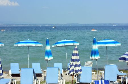 sirmione: Beach with colorful umbrellas in Sirmione near Garda lake