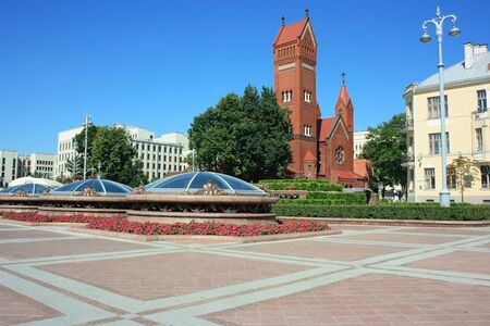minsk: Independence square in Minsk with Government palace, church and shopping center underground Stock Photo