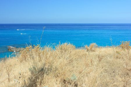 torrid: Typical torrid view of Calabria: extremely dry grass and azzure sea Stock Photo
