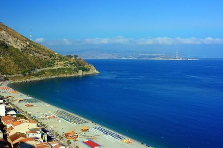 calabria: View on Charybdis town in Sicily from Scylla town in Calabria through Messina strait in Italia