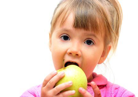 Lovely -girl eating fresh green apple Stock Photo - 3725776