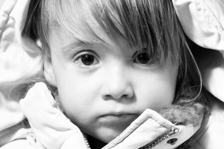 Winter-dressed baby-girl potrait in monochrome photo