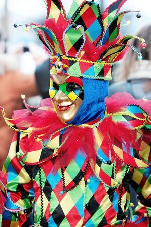 mardigras: Portrait of multicolored venetian mask of smiling joker Stock Photo