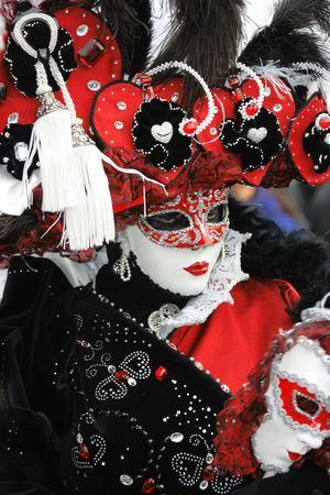 mardigras: Venetian mask in red-black-white garment with precious gems