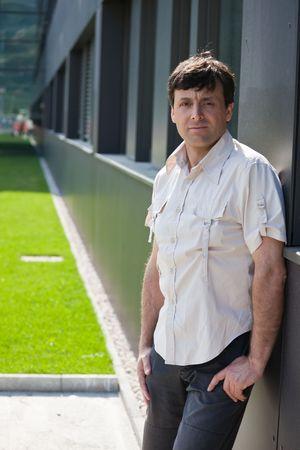urbanistic: Fashionable mid aged man in urbanistic landscape Stock Photo