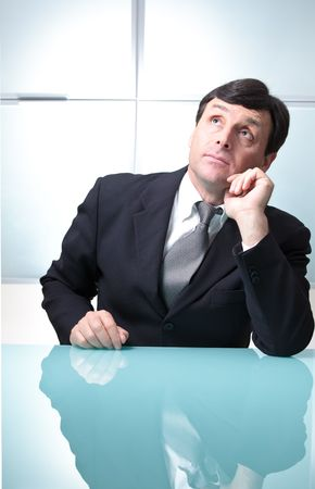 Businessman dreaming in his office photo