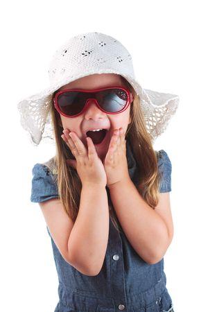 Little girl expressing amazement isolated on white background photo