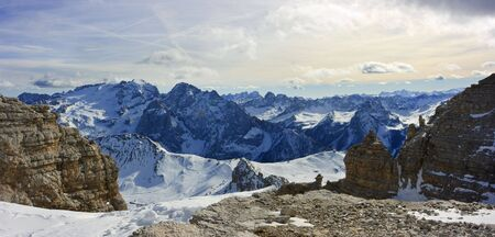 Dolomites landscape panaroma of two shots. View on mountain range from the point 3000m above the sea level  photo