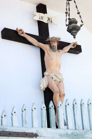 inri: Fragment of typical crucifix symbol of christianity. Wooden statue in Trento, Italy