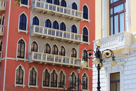 eclectic: Eclectic architecture in Reggio Calabria: red palace in venetian gothic style, lantern in baroque style, white building in liberty style Stock Photo