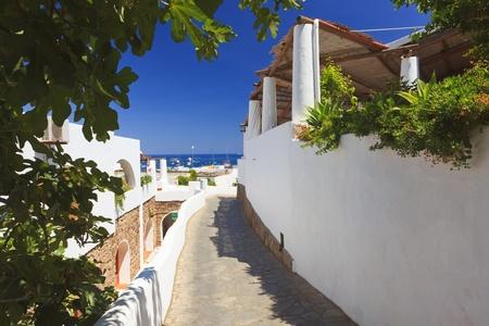 panarea: Street towards the sea on Panarea island Stock Photo