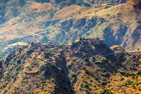 torrid: Ruins of Medieval Castle Ruffo of Amendolea in Condofuri that belongs to Bovesia area of the province of Reggio Calabria in Italy