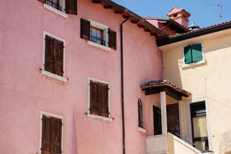 italian architecture: Colorful italian architecture with strange window disposition in Bardolino Stock Photo