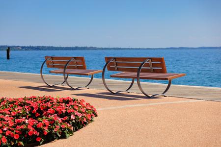 promenade: Bardolino promenade near lake Garda, typical benches