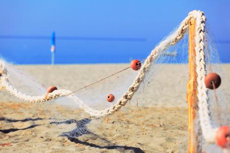 fish net: Drying fish net near the sea. Candid shot