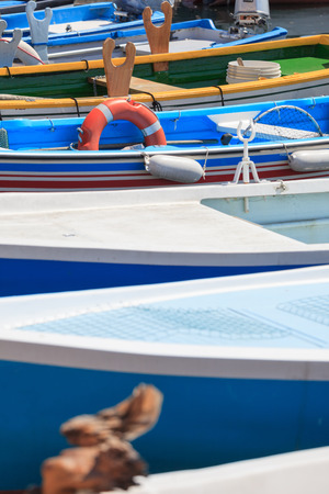 Absract composition of boats with a focus on a red lifebuoy Stock Photo