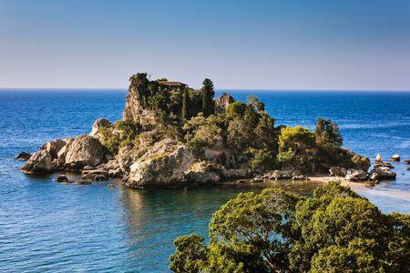 bella: Small island nearby Taormina in Sicily, named Isola Bella, at sunrise