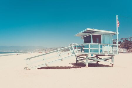 Iconic lifeguard hut on a beach of Santa Monica, California, vintage retro toned in punchy pastel