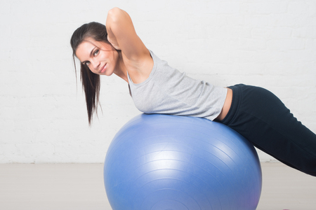 Beautiful sport woman doing fitness exercise on ball. Pilates, healthy back, sports, health.