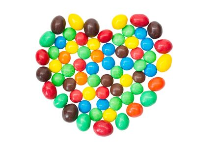 obesidad infantil: Multicolor SONY, caramelos de colores, dulces en forma de coraz�n aislado en un blanco backgroundDSC